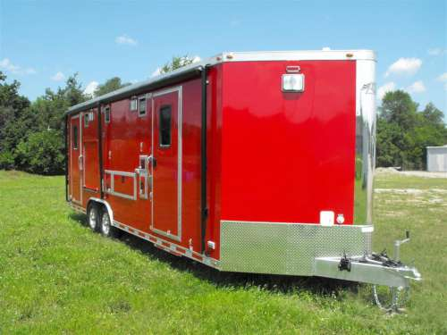 E169578 #002 Curb Front Showing Side Doors and Awning Stowed All Exterior Compartments Stowed
